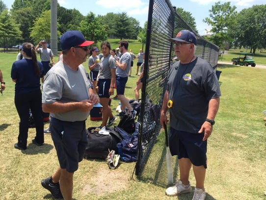 UA coach Mike Candrea meets Auburn coach Clint Myers