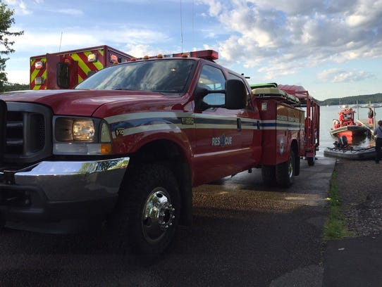 Rescue trucks and boats respond to reports of a boat