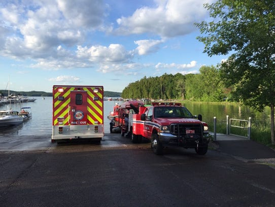 Rescue personnel at the scene of a boat collision in