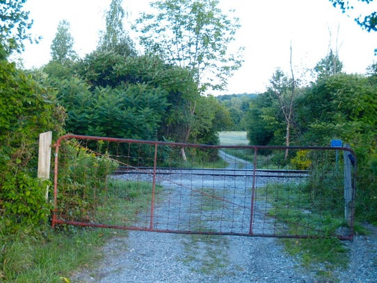 A fence that sits above the railroad tracks on Shelburne