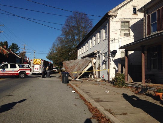 A vehicle crashed into a structure on West King Street