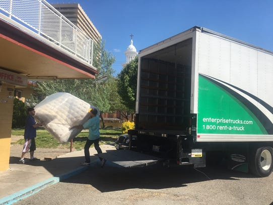 A rental truck pulls in to the Town House Motor Lodge