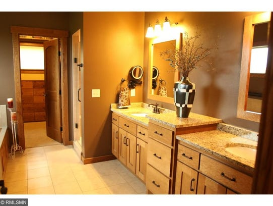 Granite counter tops are a feature of a bathroom at