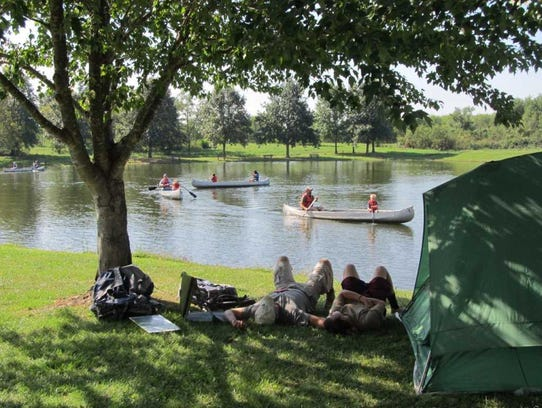 Camping and canoeing go together.