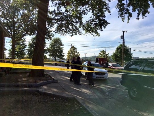 Police investigate at the scene of a shooting at Cumberland