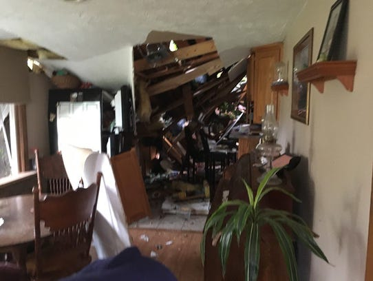 Storms Monday night left this mess inside Sherri Hager's