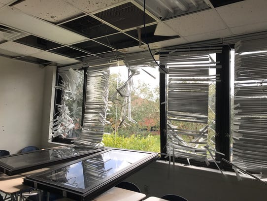 A classroom window is blown in by the wind from Hurricane