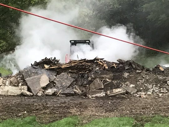 A photo taken by a neighbor shows burning debris at