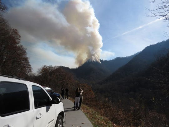 Smoke billows from the Chimney Tops 2 fire as it approaches Gatlinburg from the Great Smoky Mountains National Park on Nov. 28, 2016.
