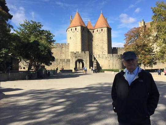 Rob Newcomer stands at the entrance to Carcassone Castle