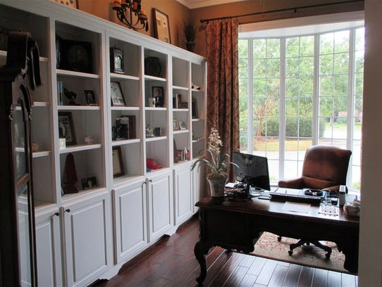 Library or office area has a French door entry, built
