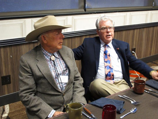 Southern Nevada rancher Cliven Bundy, left, listens