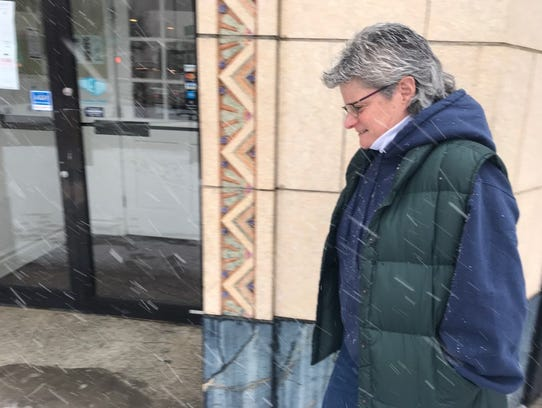 City of Poughkeepsie resident Mary Linge walks up to