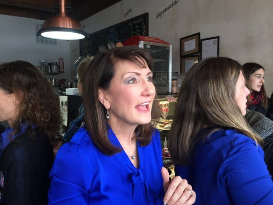 In this Feb. 13, 2018, photo, Democratic candidate for the 3rd congressional district Marie Newman speaks with supporters at a campaign event in LaGrange, Ill. Newman is a political newcomer challenging U.S. Rep. Dan Lipinski in the March 20 primary.