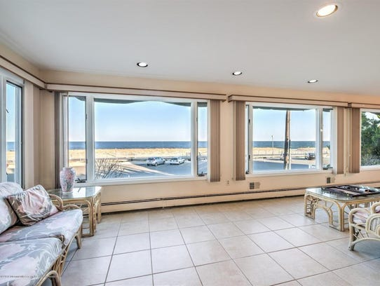 The attractive home provides many elevated views through the custom oversized windows.