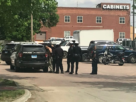 Police activity near the intersection of East 8th Street