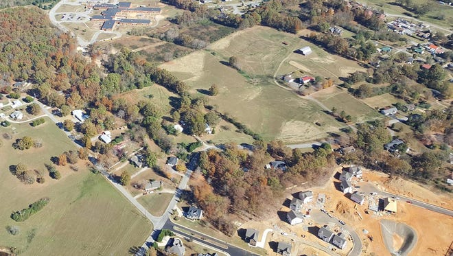 In this aerial view of Fairview along Cox Pike, the lower right corner shows the construction of new rooftops in the Western Woods Subdivision.