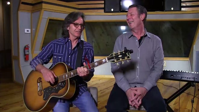 Jeff Hanna, left, and Bart Herbison discuss songwriting.