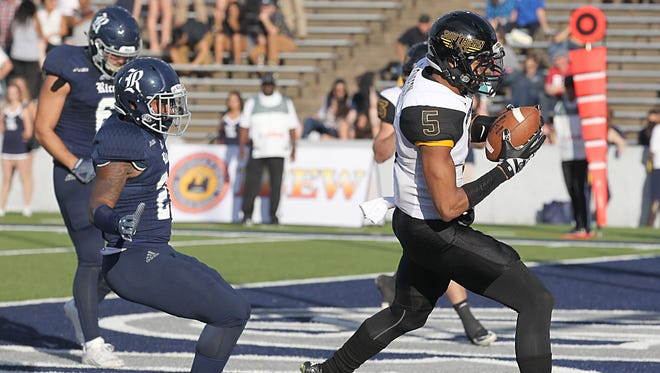 Southern Miss Golden Eagles wide receiver DJ Thompson (5) scores a touchdown against the Rice Owls in the second quarter at Rice Stadium.