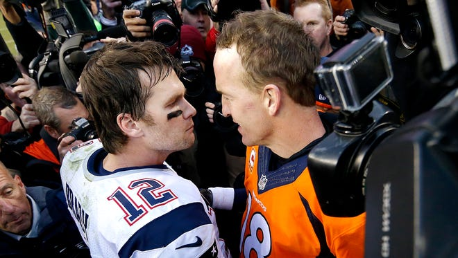 New England Patriots quarterback Tom Brady (12) and Denver Broncos quarterback Peyton Manning speak to one another following the NFL football AFC Championship game between the Denver Broncos and the New England Patriots, Sunday, Jan. 24, 2016, in Denver.