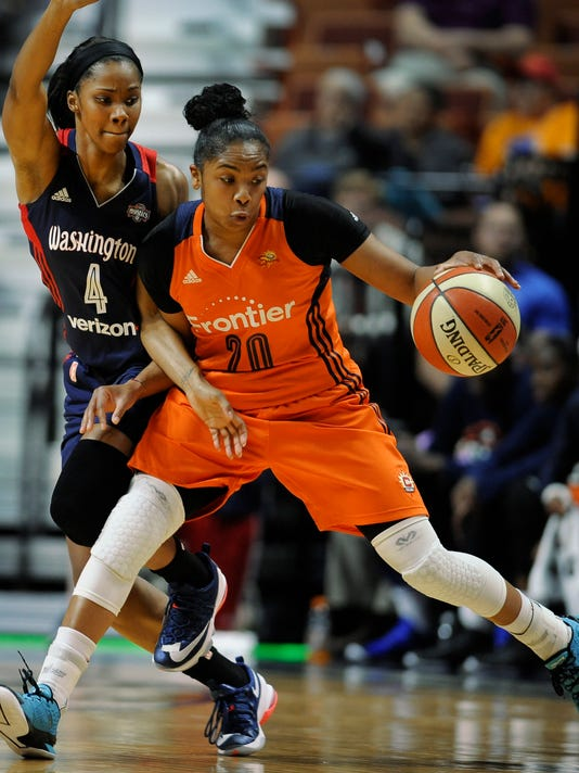 Connecticut Sun's Alex Bentley, right, dribbles as Washington Mystics' Tayler Hill, left, defends, during the first half of a WNBA basketball game, Tuesday, June 14, 2016, in Uncasville, Conn. (AP Photo/Jessica Hill)