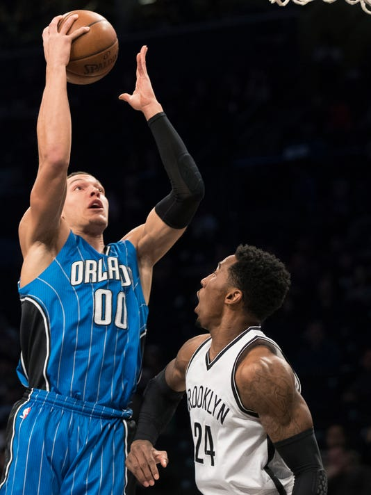 Orlando Magic forward Aaron Gordon (00) goes to the basket past Brooklyn Nets forward Rondae Hollis-Jefferson during the first half of an NBA basketball game, Saturday, April 1, 2017, in New York. (AP Photo/Mary Altaffer)
