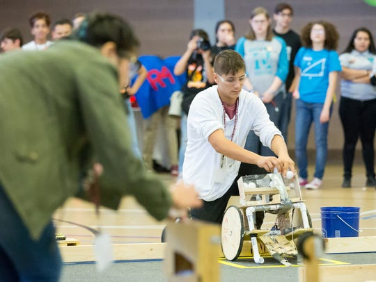 Students participate in the 16th annual NM BEST Robotics Competition at New Mexico State University's James B. Delamater Activity Center on Saturday, October 21, 2017.