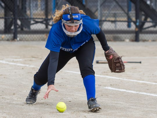 Kara Suwarsky of Kellogg Community College reaches for the ball in a game against Grand Rapids Community College.