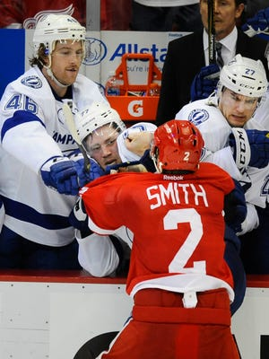 Wings' Brendan Smith and Lightning's Victor Hedman fight after the third period ended.