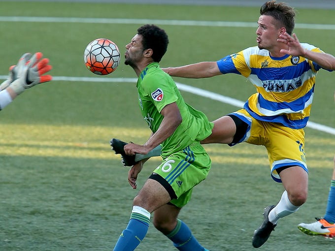Sounders U23's Andrew Wheeler-Ominu heads the ball to goalie Paul Christiansen's outstretched hands as Kitsap's  Connor Bevans tries to get a foot on the ball at Gordon Field on Wednesday, June 29, 2016.