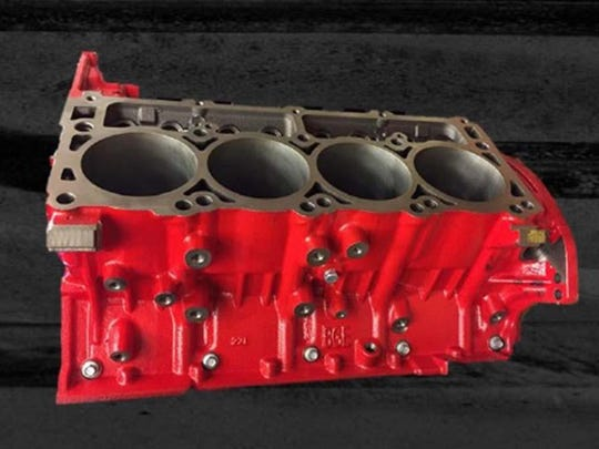 """Engineer Chris Cowland's team painted the V-8 cylinder block """"Demon Red."""""""
