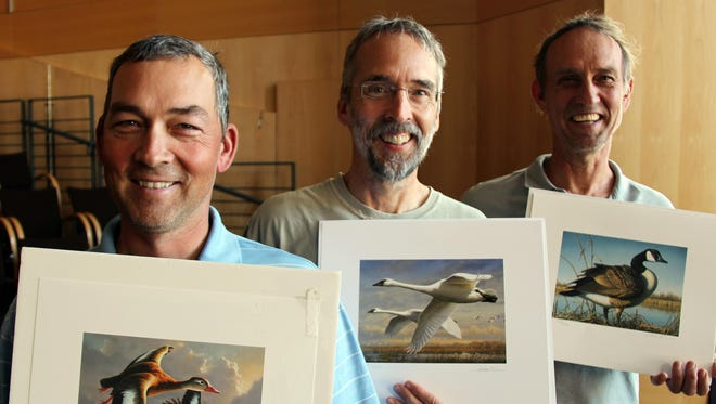 The Hautman brothers of Minnesota, left to right: James (Chaska), Joseph (Plymouth) and Robert (Delano) have won 12 of the past 28 Federal Duck Stamp contests between them. They visited the MPR studios in St. Paul on Aug. 29, 2016.