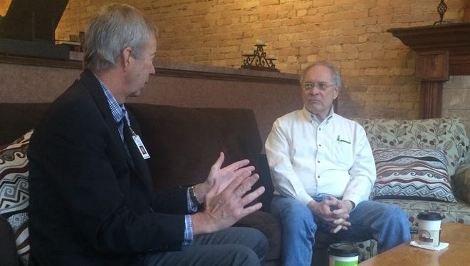 Dr. Dean Gruner, left, president and CEO of ThedaCare, talks to Spencer Rotzel of Appleton about the proposed new hospital on Thursday, April 21, 2016 at Copper Rock Coffee Company on College Avenue.