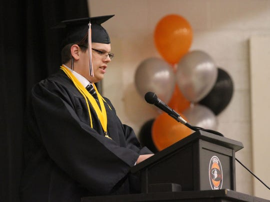 Lucas Salutatorian, Samuel Taylor, gave an address to the crowd during the annual commencement ceremony on Sunday afternoon in the school's gymnasium.