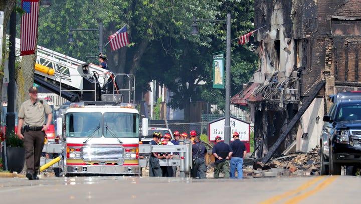 Emergency crews look at damage along West Main Street