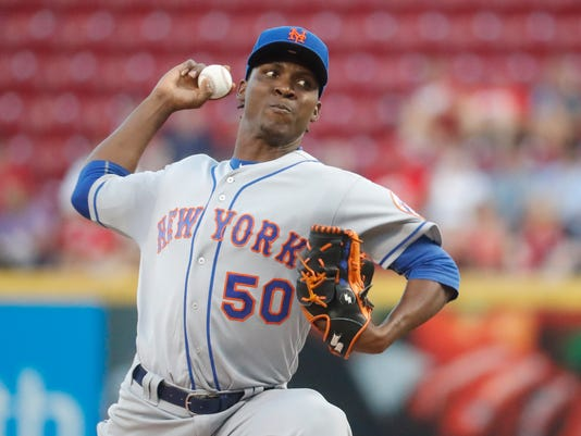 New York Mets pitcher Rafael Montero throws during the first inning of a baseball game against the Cincinnati Reds, Tuesday, Sept. 6, 2016, in Cincinnati. (AP Photo/John Minchillo)