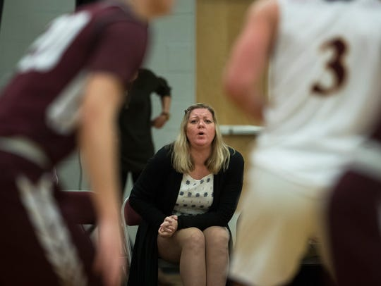 Toms River South assistant boys basketball coach Sandy Madigan watches the action from the bench Tuesday night.