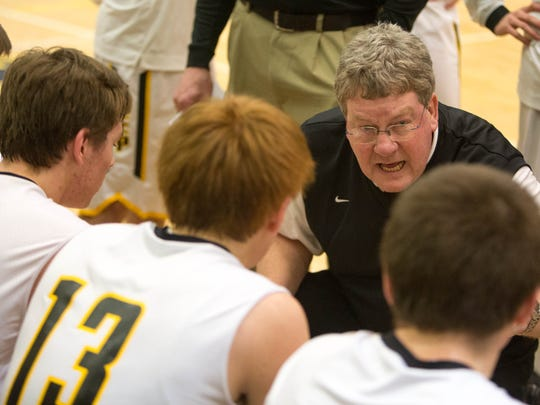 Southeast Polk boys' basketball coach Gary Belger talks to his team during a February game against North.