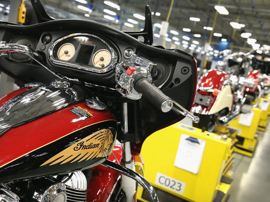 An Indian Chieftain (L) motorcycle sits on the assembly line at the Polaris Industries factory on August 8, 2014 in Spirit Lake.
