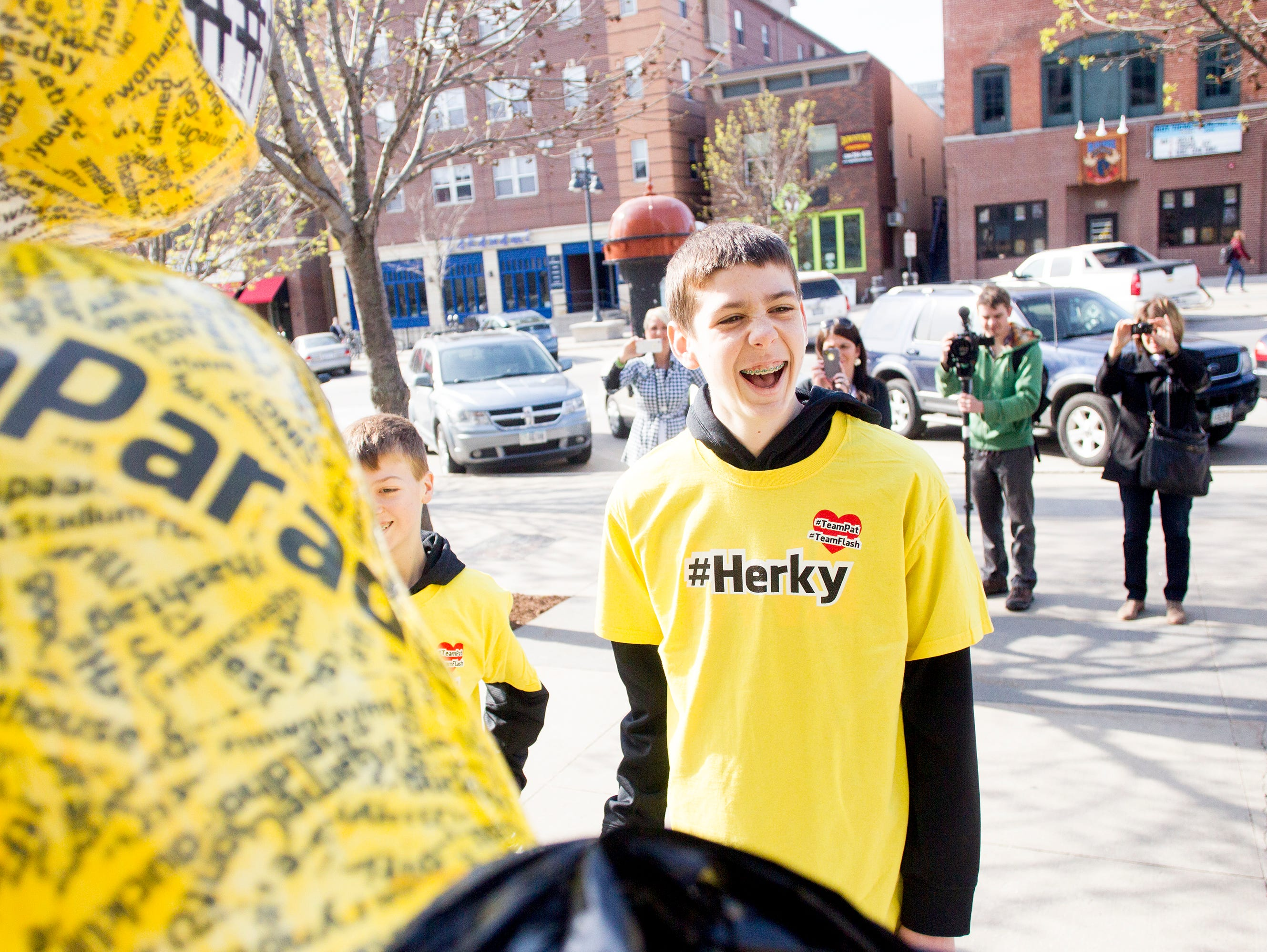 Patrick McCaffery, son of Iowa Men's Basketball Head Coach Fran McCaffery, smiles as he unveils the #Herky statue as part of the Herky on Parade series along Iowa Avenue in Iowa City, IA on Monday morning, May 5, 2014. Patrick, 14, had a tumor surgically removed from his thyroid in March 2014, which was shown to be cancerous. He was asked to unveil the #Herky statue after his own #TeamPat was recognized across the country including NBA star Chris Paul with the L.A. Clippers.