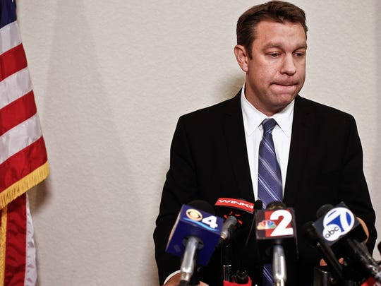 Congressman Trey Radel takes a moment to himself as he addresses the media at his office in Cape Coral. Earlier on Wednesday, Radel plead guilty to misdemeanor cocaine possession, receiving a 1-year probation sentence.