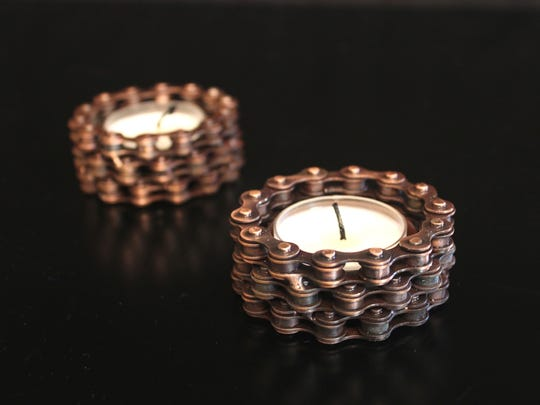 Bike chains recycled into candle holders provide business education to artisans in India.