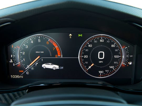 The 2014 Cadillac CTS Vsport Twin Turbo has a reconfigurable LCD instrument cluster that can show analog or digital displays.