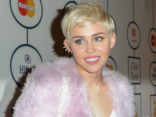 BEVERLY HILLS, CA - JANUARY 25:  Singer Miley Cyrus arrives at the 2014 HYUNDAI / GRAMMYs Clive Davis Pre-GRAMMY Gala Activation + Equus Fleet Arrivals at The Beverly Hilton Hotel on January 25, 2014 in Beverly Hills, California.  (Photo by Chelsea Lauren/Getty Images for Hyundai)