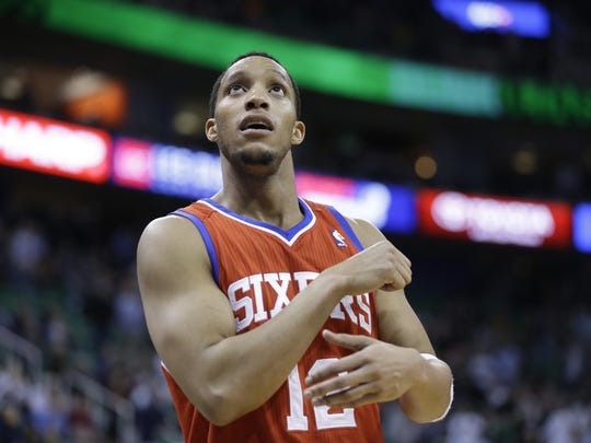 Philadelphia 76ers' Evan Turner (12) looks at the scoreboard in the second half of an NBA basketball game against the Utah Jazz Feb. 12, 2014, in Salt Lake City.