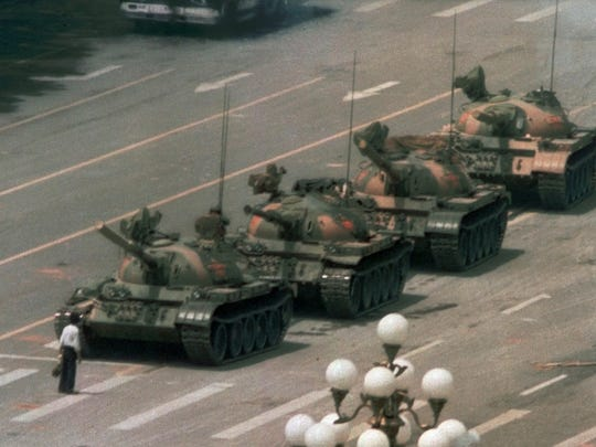 In this June 5, 1989 file photo, a Chinese man stands alone to block a line of tanks heading east on Beijing's Changan Blvd. from Tiananmen Square in Beijing. A quarter century after the Communist Party?s attack on demonstrations centered on Tiananmen Square on June 4, 1989, the ruling party prohibits public discussion and 1989 is banned from textbooks and Chinese websites.