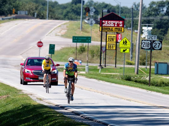 Riders make their way into Hills in route to Terry Trueblood Park as part of the Gran Gable bike ride on Sunday, August 31, 2014. The fondo offered a choice of 25, 60, or 100 mile loops that showcased the partnership between Coach Gable, the Iowa City/Coralville Area Convention & Visitors Bureau, the Iowa Bicycle Coalition, and RAGBRAI. All proceeds from the granGABLE fondo will benefit the Iowa Bicycle Coalition and Hawkeye Wrestling Club.