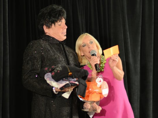 Designer Dennis Tapp and Emcee Kirby Adams at the Skyrise Fashion Show at the Muhammed Ali Center Saturday night. September 7, 2013.