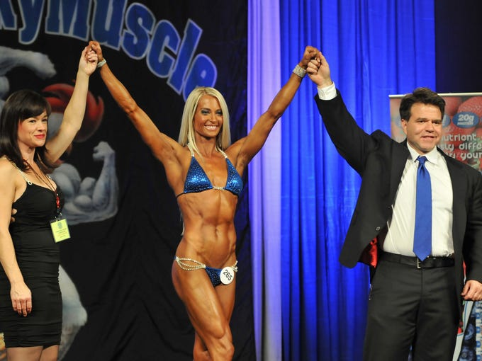 Molli Smith, center, won the overall Women's Bikini competition in the KY Muscle Strength and Fitness Extravaganza at the KY International Convention Center on Saturday. November 9, 2013.