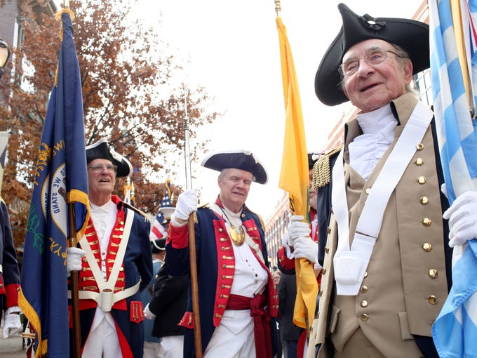 Jack Early, right, representing the Society of Cincinnati is seen during the UAW 862/Ford Motor Company Veterans Day Parade. November 11, 2013